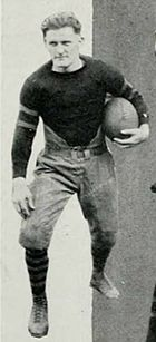 Rupert Smith in uniform, posing with a football