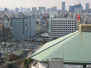Ryōgoku - Ryōgoku Station and the surrounding area, with the Ryōgoku Kokugikan sumo stadium in the foreground