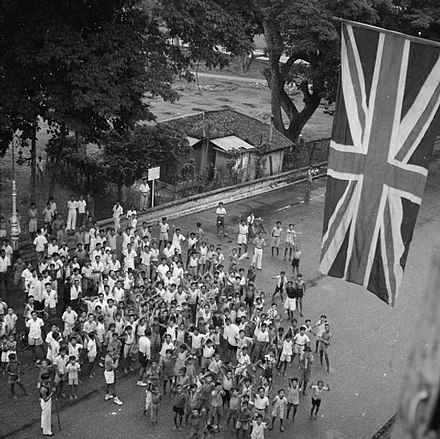 A cheering crowd welcome the return of British forces on 5 September 1945 - Japanese occupation of Singapore