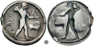 Caulonia (ancient city) - Nomos from Caulonia with Apollo holding a laurel branch and a stag, c. 525-500 BC