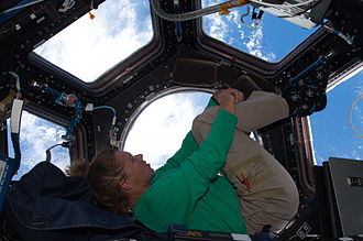 Sandra Magnus - Magnus in the Cupola aboard the International Space Station during STS-135.