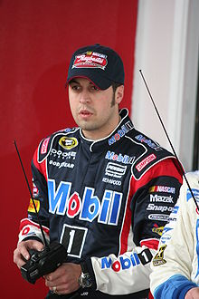 Hornish, in uniform and cap, using a remote car controller