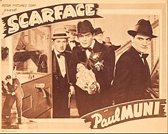 "Tony holds a covered Tommy gun with other characters around him in a promotional card for the film stating ""Scarface"" with Paul Muni"