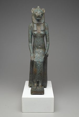Cats in ancient Egypt - Seated Wadjet, 664 BC – 332 BC. Bronze. Usually seen in the form of a cobra, the goddess Wadjet was depicted as a lion-headed woman in the later periods of Egyptian history. (Brooklyn Museum collection)