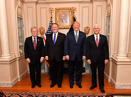 John R. Bolton and Mike Pompeo with President Donald Trump in May 2018 Secretary Pompeo Poses for a Photo With Advisor Bolton, President Trump and Vice President Pence (41811551572).jpg