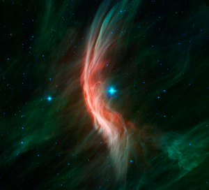 Zeta Ophiuchi - Infrared image of the shockwave (yellow arc) created by the runaway star Zeta Ophiuchi in an interstellar dust cloud.