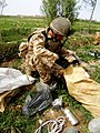 Soldier Sorts Through Captured Bomb Making Parts MOD 45151231.jpg