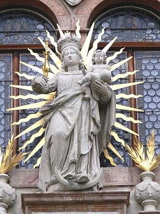 Woman of the Apocalypse - A statue of Our Lady of Victory (1654), shown with crescent moon and solar rays, portal of Schlägl monastery church.