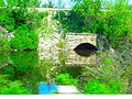 Stone arch bridge on WSOR Formerly C^NW Railway - panoramio.jpg
