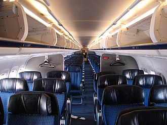 McDonnell Douglas MD-80 - five abreast coach seating and four-abreast premium seating