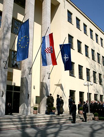 The NATO flag being raised in a ceremony marking Croatia's joining of the alliance in 2009