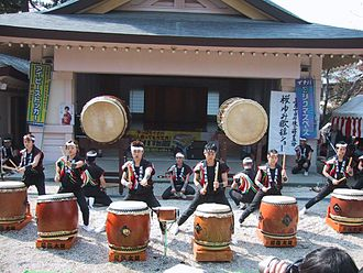 Taiko - A kumi-daiko group performing in Aichi, Japan wearing hachimaki
