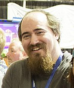 Tarn Adams is seen at a convention.