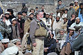 Ted Wittenberger, center, a U.S. Agency for International Development representative with the Kunar Provincial Reconstruction Team, speaks to Afghan residents during a shura, or meeting, in Lachey village 091207-A-AO884-319.jpg