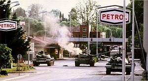 Rožna Dolina - Slovenian forces attacking a tank near the Rožna Dolina international border crossing, 1991.
