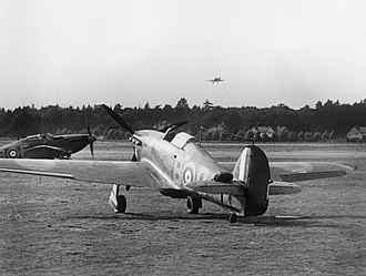 RAF Debden - The Battle of Britain.  Hawker Hurricanes of No. 17 Squadron on the ground at Debden, while another comes in to land, July 1940.