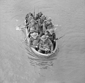 Royal Sussex Regiment - An infantry section from the Royal Sussex Regiment stage a river crossing in a collapsible boat, Chichester, 25 March 1941.
