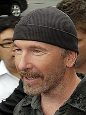 U2 guitarist The Edge wearing a knit cap 012996f8cb1