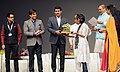 The Minister of State for Information & Broadcasting, Col. Rajyavardhan Singh Rathore presenting an award at the closing ceremony of the 1st International Film Festival for Persons with Disabilities.jpg