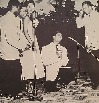 The Platters - The Platters performing in their early years. From left to right: Reed, Williams, Taylor, Lynch (on his knee), and Robi.