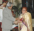 The President, Dr. A.P.J. Abdul Kalam presenting the Padma Vibhushan Award – 2006 to Dr. (Ms.) Nirmala Deshpande, a well-known Gandhian, in New Delhi on March 20, 2006.jpg
