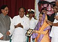 The President, Smt. Pratibha Devisingh Patil receives the first copy of the book of PN Panicker, at the closing ceremony of PN Panicker Centenary Celebrations, at Kanakakkunnu Palace, Kerala on August 13, 2010.jpg