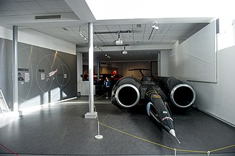 ThrustSSC on display in the Coventry Transport Museum's Landspeed Gallery Thrust SSC Wide shot.jpg