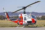 Touchdown Helicopters (VH-OXE) Bell UH-1H Iroquois at Wagga Wagga Airport (1).jpg