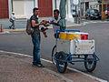 Toy car salesman showing a craft chicha vendor.jpg