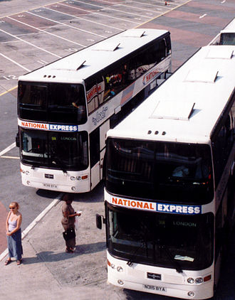 Trathens Travel Services - National Express liveried double-deck Van Hool coaches in Plymouth in 2001