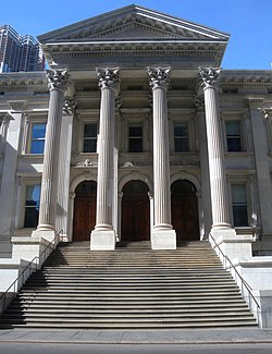 A close-up of the front steps and entrance portico of the Tweed Courthouse