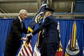 U.S. Air Force Gen. C. Robert Kehler, right, hands the U.S. Strategic Command (USSTRATCOM) colors to Secretary of Defense Chuck Hagel during a change of command ceremony Nov. 15, 2013, at Offutt Air Force Base 131115-D-BW835-384.jpg