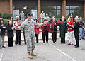 U.S. Army Col. Jackie J. Bryant, the chief of staff of ATZH, Fort Gordon, leads caroling songs for personnel attending the Christmas House Annual Ceremony at Fort Gordon, Ga. 081128-A-NF756-003.jpg