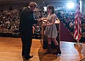 U.S. Department of Agriculture (USDA) Secretary Tom Vilsack is presented a 4-H pin by Laura Willis (NC) after his keynote remarks and question and answer session with approximately 300 youth members.jpg
