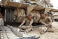 U.S. Marine Corps Sgt. Christopher Cannella, left, and Cpl. Wilmer Rivas, tank mechanics assigned to Delta Company, 1st Tank Battalion, prepare a tank track while conducting maintenance on an M88A2 Hercules 130507-M-YH552-106.jpg