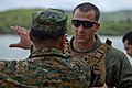 U.S. Marine Corps Staff Sgt. Derek Evans, right, assigned to the 2nd Assault Amphibian Battalion, 2nd Marine Division, discusses an assault plan with a Thai marine during Cooperation Afloat Readiness 130606-M-VK320-034.jpg