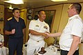 U.S. Navy Cmdr. Leopoldo Albea, center, the commanding officer of the guided missile destroyer USS Wayne E. Meyer (DDG 108), meets with Russian navy Adm. A. Saprykin, commanding officer, Russian Task Group 1 120202-N-OH194-042.jpg