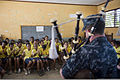 U.S. Navy Ensign Alexander C. Crow, assigned to the amphibious transport dock ship USS Denver (LPD 9), plays bagpipes for children during a cultural exchange community service program Aug. 28, 2013, at Bidau 130828-N-KL846-446.jpg