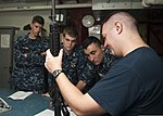 U.S. Navy Gunner's Mate 1st Class Matthew Quave, right, conducts weapons training with midshipmen in the armory aboard the aircraft carrier USS Nimitz (CVN 68) July 18, 2013, in the Arabian Sea 130718-N-LP801-006.jpg