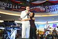 U.S. Navy Musician 3rd Class Anthony Chiles, assigned to the U.S. 7th Fleet Band contemporary music ensemble Orient Express embraces a Philippine woman while performing a rap song for the audience inside SM City 120303-N-SM668-016.jpg