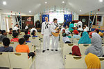 U.S. Navy Musicians 3rd Class Gabriel Brown, center left, and Daniel Weber, center right, both with the U.S. 7th Fleet Band's Pacific Ambassadors, perform for Singaporean children at the Jamiyah Children's Home 130611-N-GR655-033.jpg