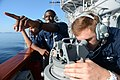 U.S. Navy Operations Specialist Seaman Nickolas Baker, left, and Quartermaster Seaman Weston War, assigned to the guided missile cruiser USS Antietam (CG 54), take a bearing as the ship prepares to enter port 130819-N-TG831-090.jpg