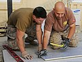 U.S. Navy Utilitiesman 1st Class Teodor Medina, right, and Utilitiesman 3rd Class Kyle Kretzer, both with Naval Mobile Construction Battalion 15, prepare duct work for a project supporting Combined Special 130527-A-CV700-006.jpg