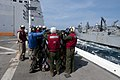 U.S. Sailors and Marines retrieve supplies onboard the amphibious transport dock ship USS New Orleans (LPD 18) during a replenishment at sea in the Philippine Sea Dec. 10, 2011 111210-N-PB383-820.jpg