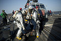 U.S. Sailors conduct a simulated rescue of a pilot during a crash and salvage drill aboard the guided missile destroyer USS William P. Lawrence (DDG 110) June 18, 2013, in the U.S. 5th Fleet area 130618-N-ZQ631-079.jpg