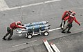 U.S. Sailors move ordnance across the flight deck aboard the aircraft carrier USS Nimitz (CVN 68) June 10, 2013, while underway in the Indian Ocean 130610-N-AZ866-097.jpg