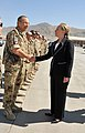 U.S. Secretary of State Hillary Rodham Clinton, right, exchanges greetings with German Army Col. Hans Buhl while visiting Kabul International Airport in Kabul, Afghanistan, July 7, 2012 120707-N-YZ252-057.jpg