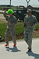 U.S. Soldiers with Multinational Battle Group East participate in a mile-long walk wearing women's footwear at Camp Bondsteel, Kosovo, April 27, 2013 130427-A-SC231-067.jpg