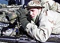 US Navy 030204-N-6920A-002 Lance Cpl. Daniel Stephens from Halifax, Nova Scotia looks through a telescope as he stands watch while Saipan transits the Suez Canal.jpg