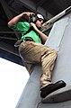 "US Navy 030222-N-5464G-008 Aviation Electronics Technician 3rd Class Jason Rayner, from Orlando, Fla., performs maintenance on an F-A-18C ""Hornet"".jpg"